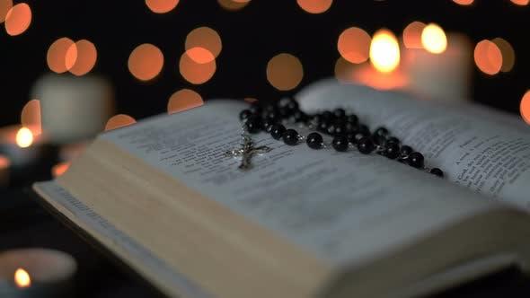 Cross And Bible With Bokeh Lights