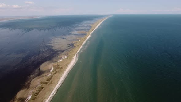 Thumbnail for Aerial Shot of an Upright Sand Spit at the Black Sea Shallow in Sunny Summer