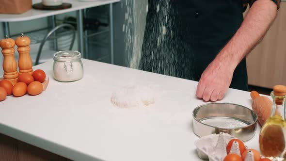 Sifting Flour on Dough for Baking