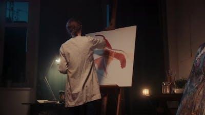 Woman Artist Paints a Picture