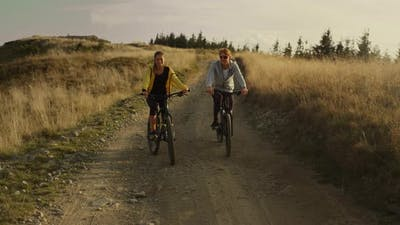 Couple Riding Sport Bicycles on Road