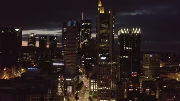 Thumbnail for Close Establishing Shot of Frankfurt Am Main, Germany Skyline at Night with City Lights and