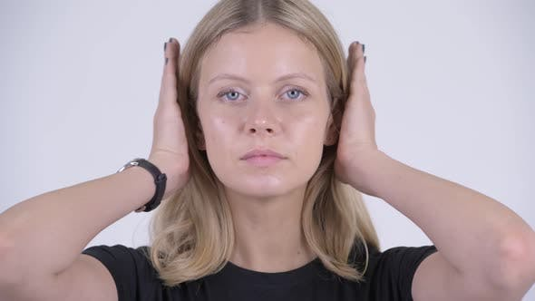 Cover Image for Face of Young Beautiful Blonde Woman Covering Ears As Three Wise Monkeys Concept