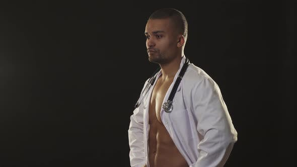 Cover Image for Handsome Sexy Male Doctor with Naked Muscular Torso Winking To the Camera