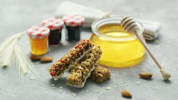 Cereal Bars and Honey in Arrangement