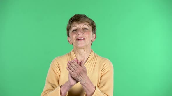 Thumbnail for Portrait of Elderly Woman Is Clapping Her Hands with Wow Happy Joy and Delight Isolated Over Green