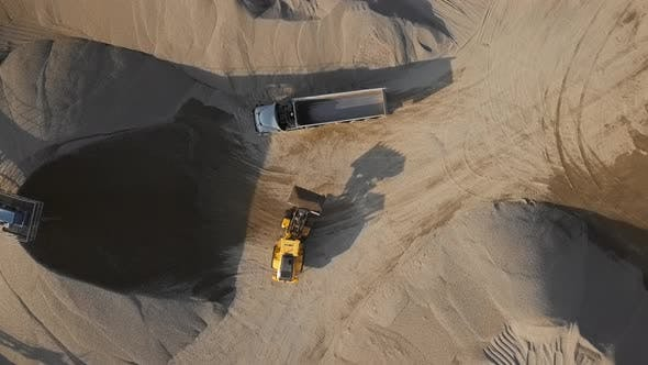 Overhead View of Bulldozer in Open Air Quarry
