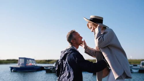 Adult Couple in Love Stand Hugging on the Pier