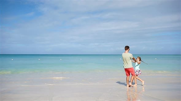 Thumbnail for Happy Father and His Adorable Little Daughter at White Sandy Beach Have Fun. Family Enjoy Vacation