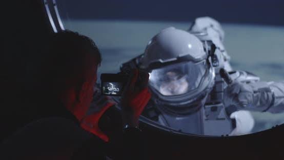 Thumbnail for Astronaut Filming Spacewalking Crewmate