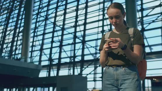 Thumbnail for A Woman Looks at the Screen of a Mobile Phone To Find Your E-ticket on the Plane
