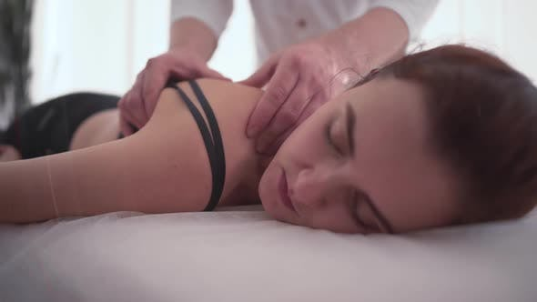 Thumbnail for Massage Therapist Does Massage for Young Female A Woman at the Doctor's Office The Doctor Touches