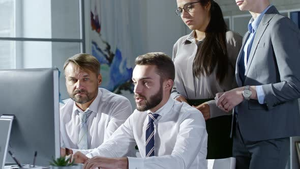 Thumbnail for Young Entrepreneur Discussing Computer Presentation with Coworkers