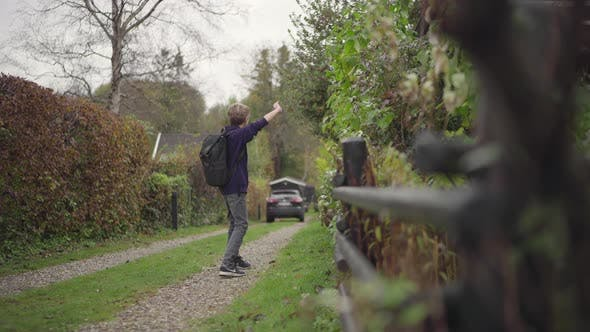 Thumbnail for Boy walking on footpath