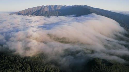Aerial View Of Sea Of Clouds Coverage Over Caldera de Taburiente National Park in La Palma island
