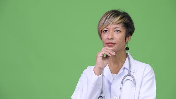 Thumbnail for Happy Mature Beautiful Multi-ethnic Woman Doctor Thinking