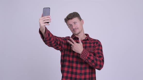 Cover Image for Happy Bearded Hipster Man Taking Selfie with Phone