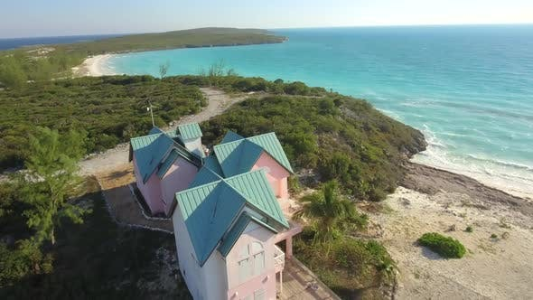 Aerial drone view clear water, houses on tropical island beach and coast in the Bahamas, Caribbean.