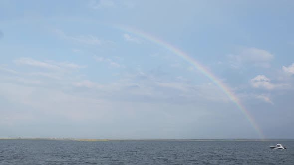 Thumbnail for Rainbow Over the River and Sailing Boat