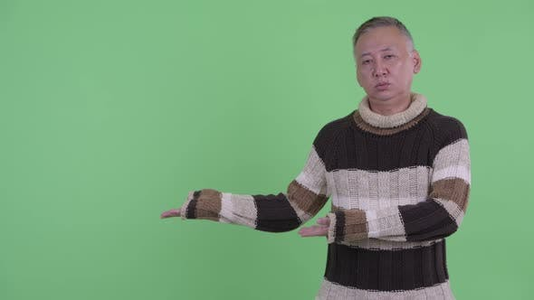 Thumbnail for Stressed Mature Japanese Man Showing Something