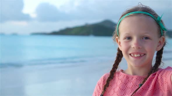 Thumbnail for Adorable Little Girl Making Selfie at Tropical White Beach. SLOW MOTION