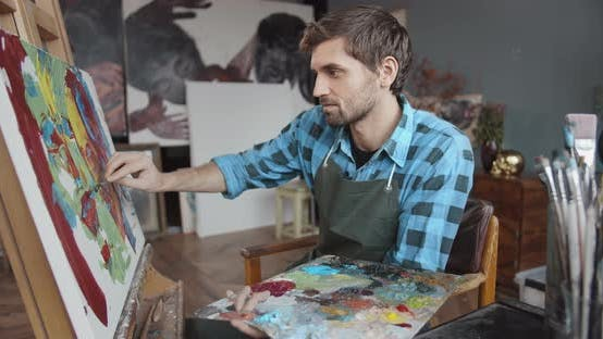 Cover Image for Male Artist Working in Studio
