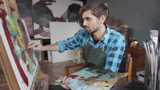 Male Artist Working in Studio