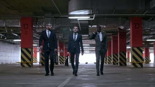 Businessmen Walking in Underground Parking Lot