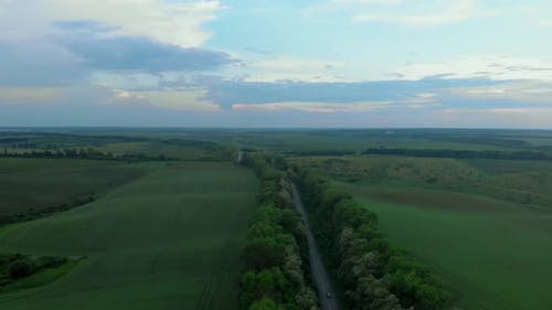 Aerial View of Road among Beautiful Green Fields