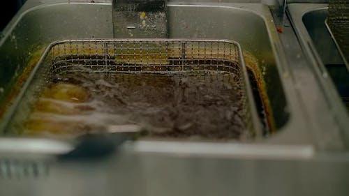Fried Japanese Rolls Are Prepared in a Fryer in Oil.