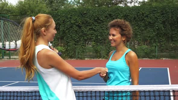 Thumbnail for Two Girls Greeting on a Tennis Court