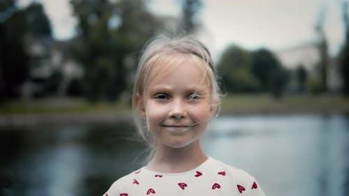 Portrait Of Cute Little Girl Outdoors