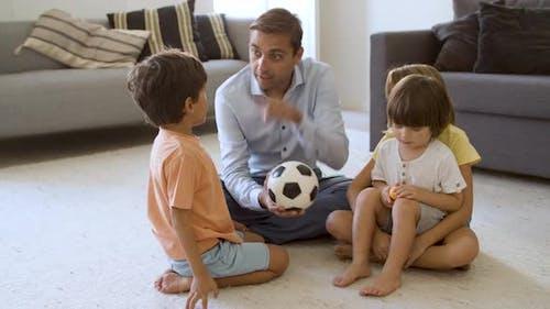 Dad Entertaining Sibling Kids at Home