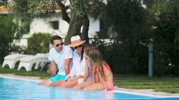 Thumbnail for Happy Family of Four in Swimming Pool