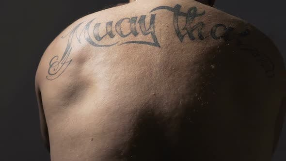 Thumbnail for View on Muay Thai Boxer Back With Tattoos Strong Man Training Before Fight
