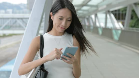 Thumbnail for Woman using cellphone in the city