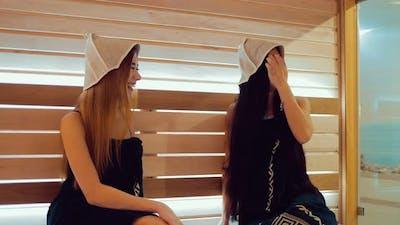 Beautiful Girls Talk in the Sauna