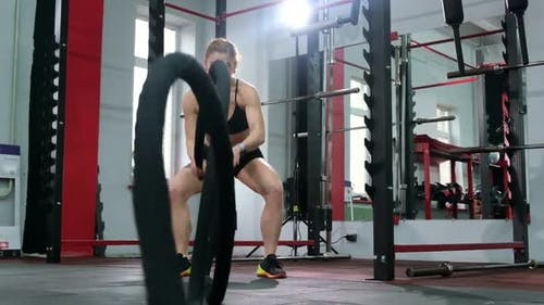 Active motivated female athlete training in gym