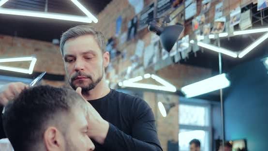 Brutal Barber Cuts a Man's Bang at a Hair Salon