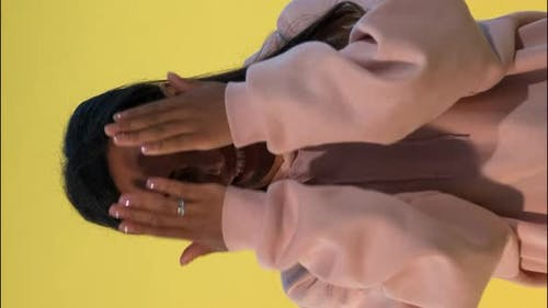Attractive Black Woman Covering Her Face with Hands, Then Opening It and Smiling.