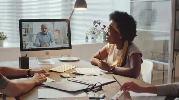 Diverse Colleagues Speaking with Manager at Online Business Meeting