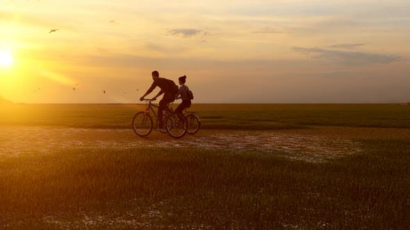 Thumbnail for Couple Taking a Bicycle Tour at Sunset