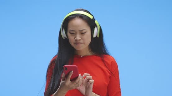 Thumbnail for Young Woman Browsing Music