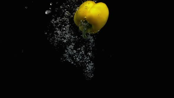 Thumbnail for Fresh Yellow Bell Pepper Fall Into Water With Lot Of Air Bubbles Black Background