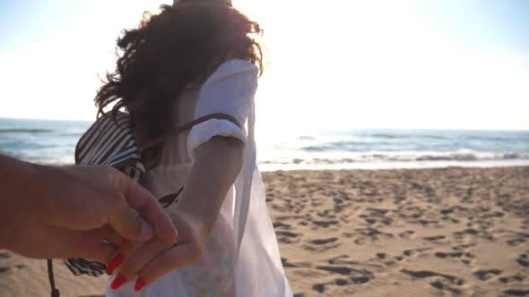 Thumbnail for Girl Holding Male Hand and Running on Tropical Exotic Beach To the Ocean. Follow Me Shot of Young