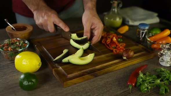 Thumbnail for Cutting Avocado on a Wooden Board
