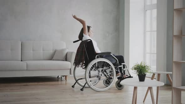 Thumbnail for Woman dancing on wheelchair