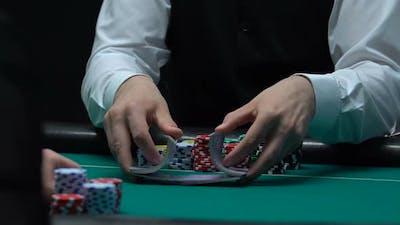 Skillful Poker Dealer Shuffling Playing Cards, Casino Business, Slow Motion