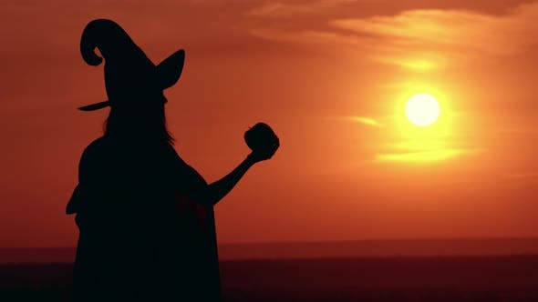 Thumbnail for Girl in Fancy Dress and Hat Evil Sorceress Sunrise View