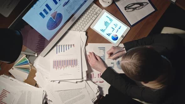 Thumbnail for Woman Analyzing Financial Statistics